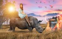 Cute girl rides the rhino